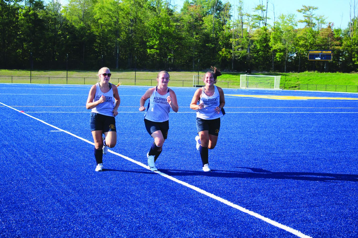 Allegheny College Women's Field Hockey teammates Becca Winton, '23, Kinsley Greenlaw, '23, and Hannah Sharp, '23, run on Sept. 5, 2019 at Robertson Athletic Complex during practice.