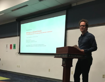 Max Kade Foundation Writer-in-Residence Asmus Trautsch discusses German literature's ability to spread awareness on climate change during his lecture on Tuesday, Sept. 24, 2019, in the Pelletier Library Collaboratory.