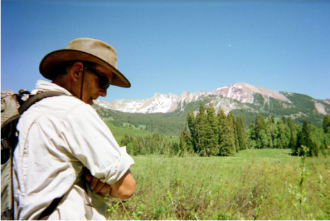 Professor Emeritus of Biology and Environmental Science Scott Wissinger stands in a field during research in summer 2019 in Colorado.