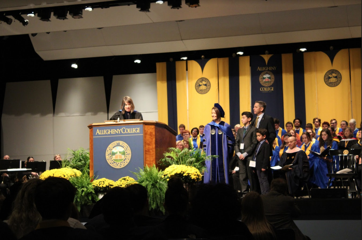 Hilary Link and her family stand on stage during Dr. Mary Feeley's speech at Link's inauguration on Friday, Oct. 18, 2019 in Shafer auditorium.