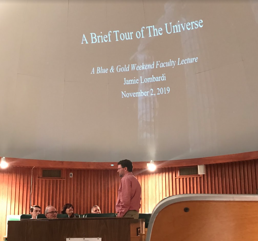 Professor of Physics James C. Lombardi Jr. talks to visiting family members of students before his lecture on Saturday, Nov. 2, 2019, in Wible Planetarium.