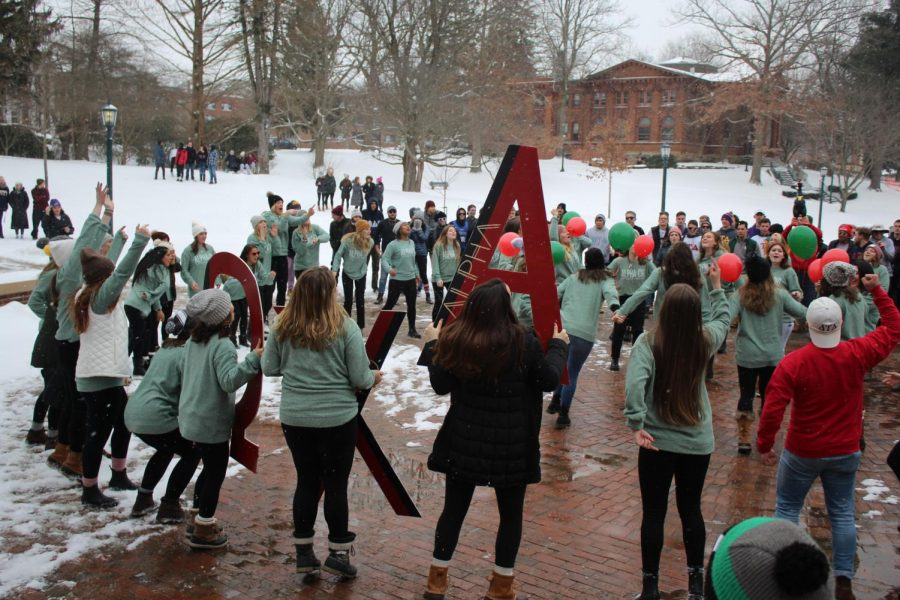 The sisters of Alpha Chi Omega bring their new members into Brooks Circle on Sunday, Jan.