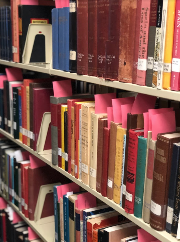 Books in the Pelletier library are being marked for removal as part of the library's recent Winnowing Project on Wednesday, Jan. 29, 2020.