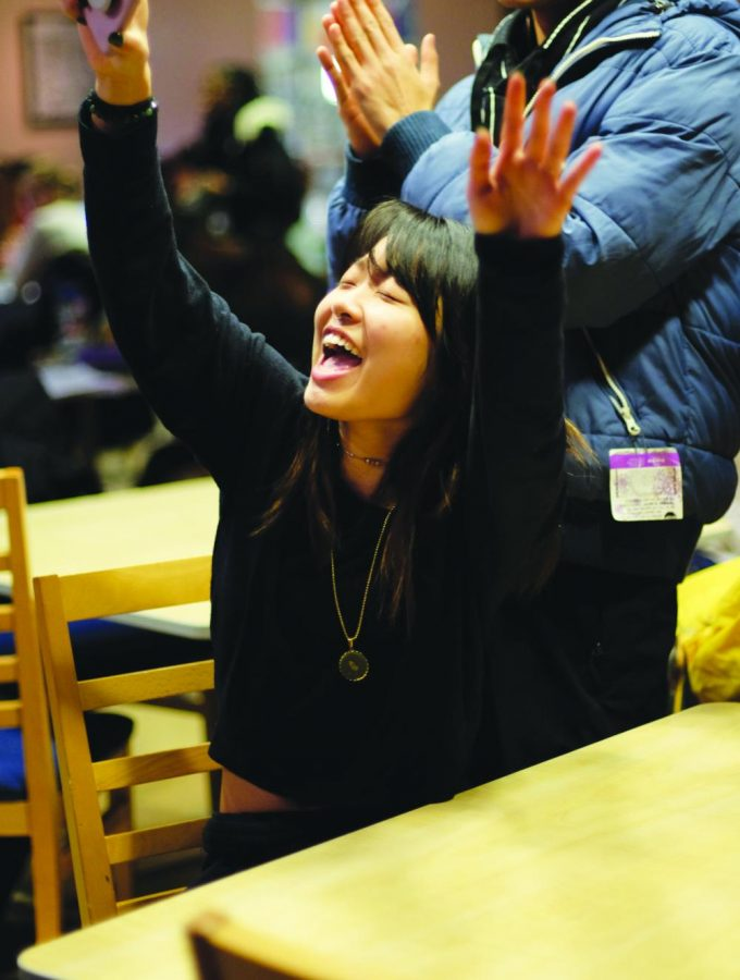 Alexis Pham, '22, enjoys the performances at Open Mic Night on Tuesday, February 11.