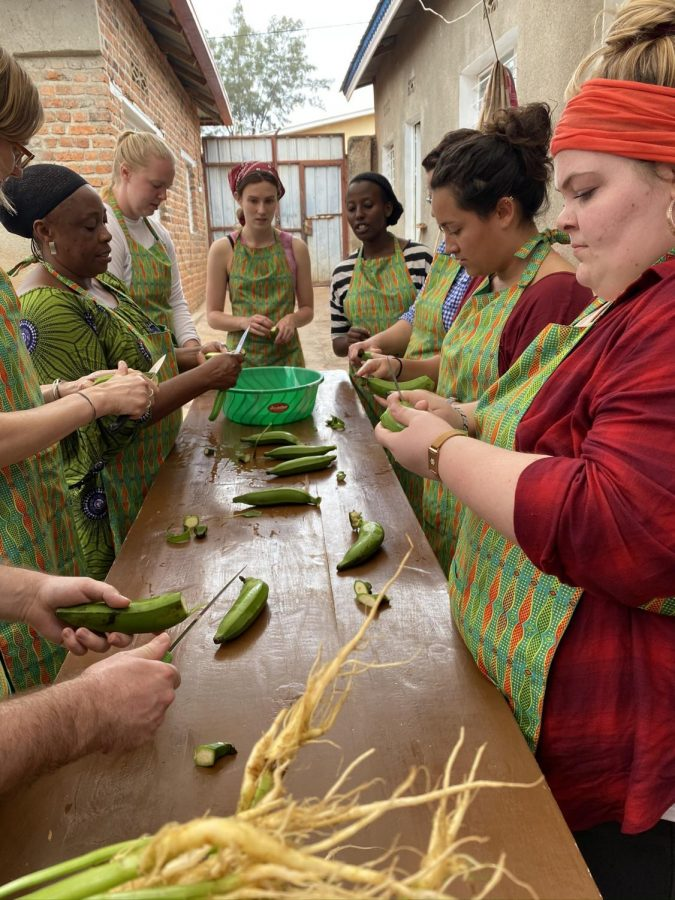Allegheny students and faculty learn traditional Rwandan dishes in January 2020 at a local women's shelter in Kigali.