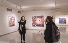 A student guide discusses artwork by Taha Heydari during a tour of the exhibition.