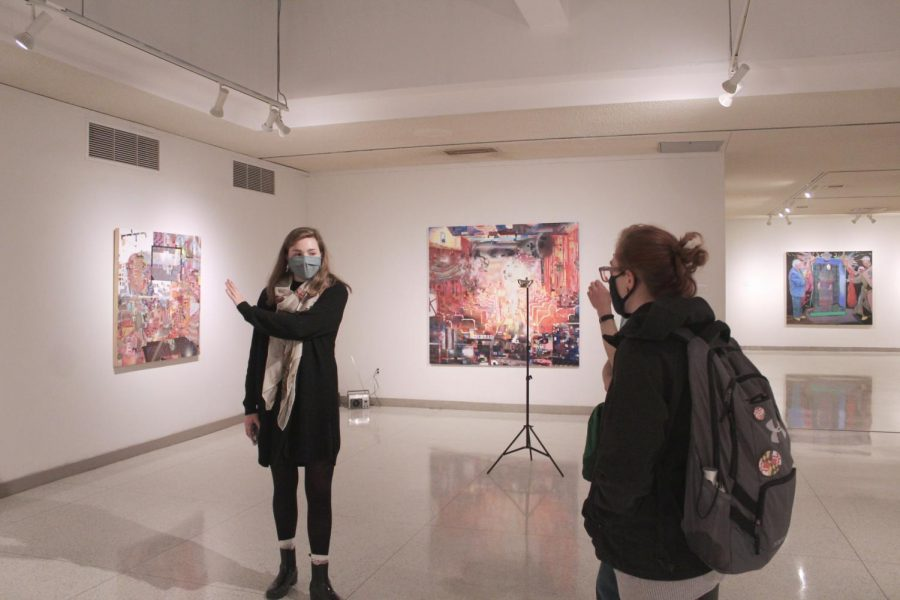 A+student+guide+discusses+artwork+by+Taha+Heydari+during+a+tour+of+the+exhibition.