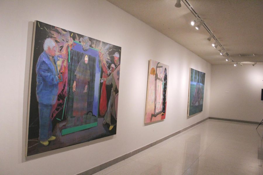 Paintings by Taha Heydari hang in the Doane Hall of Art during the 'Performance Anxiety' exhibition.