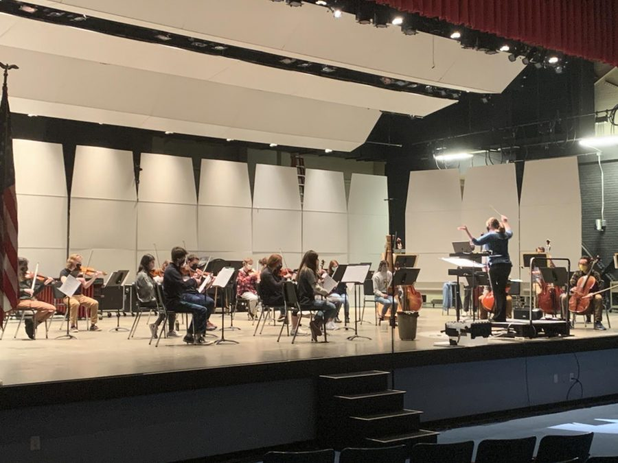 Professor Dearden conducts the Allegheny Civic Orchestra during their weekly practice in Schafer Auditorium. The orchestra is expecting to perform an outdoor concert in May.