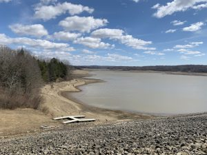Woodcock Creek Lake appears mostly empty, after dropping 21.5 feet last week.