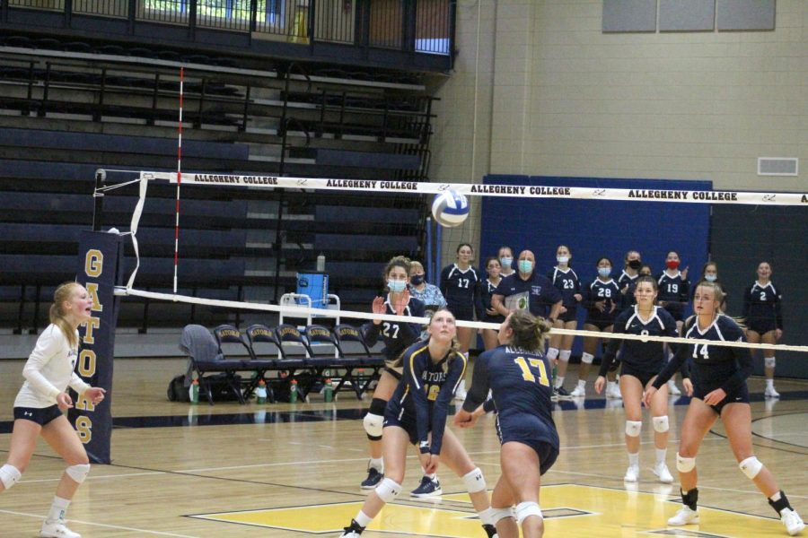 Middle Hitter Dagney Javes, '25, and Olivia D'Andrea, '22, set up to return the ball to the Titans.