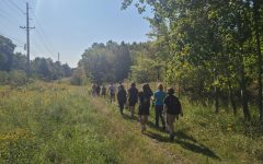 Students walk along the Lew's Land trail during the French Creek Cleanup on Saturday, Sept. 11. Another group worked on the Mill Run in Downtown Meadville.
