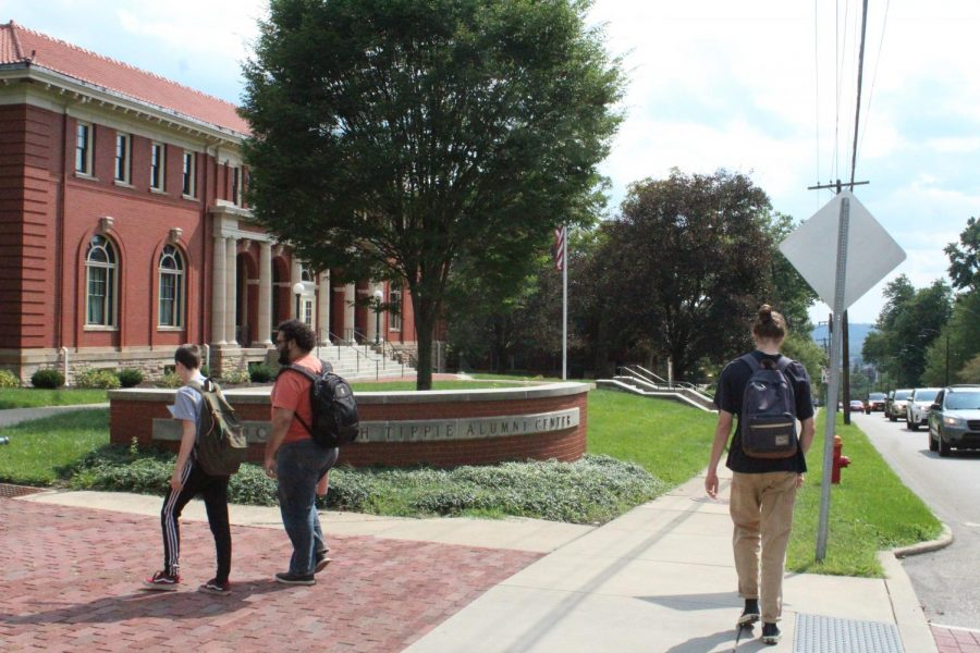 Students walk in front of the Tippie Alumni Center, where the Faculty Council meets.