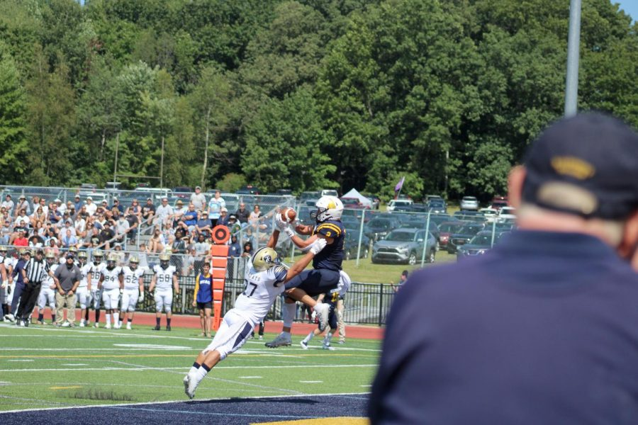 Jack Parker, '22, catches a touchdown pass in the second quarter.