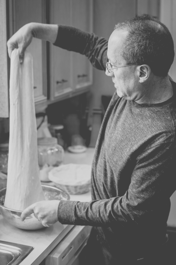 Pallant stretches the dough as he prepares sourdough bread in his home. Photo courtesy of John Mangine.