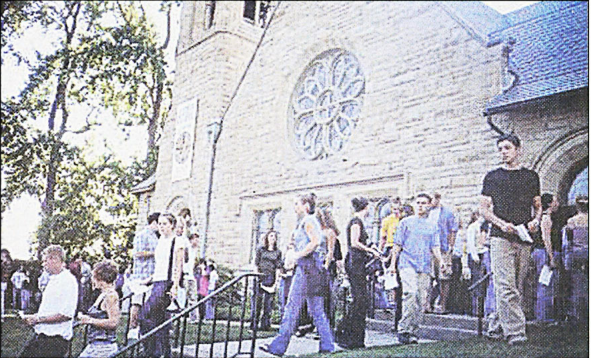 Students file out of Ford Chapel the afternoon of Sept. 11, 2001, after a memorial service for the victims of the day's violence. This photo ran as the front-page photo of the Sept. 13, 2001 edition of The Campus.