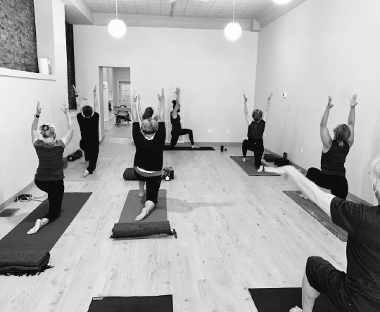 Lindsay Henry, owner of Yoga Spot Meadville, leads a class in the newly opened studio at 252 Chestnut Street.