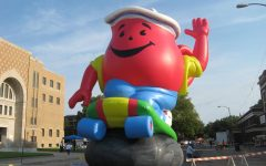 This is the Kool Aid Man riding a skateboard.