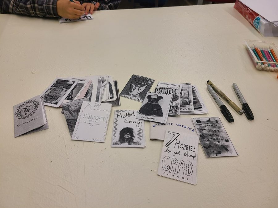Examples of Zines on a table during the workshop. Zines are short magazines that focus on a particular subject and are defined by their flexibility.