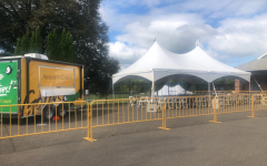 The truck and the designated area for alcoholic beverages are located inside the football stadium. Fans can stop at the truck on their way to the home seating section.