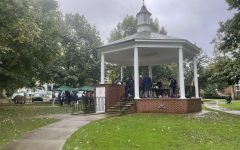 Members of the greater Meadville community gather under and around the gazebo in Diamond Park on Oct. 16 prior to volunteering.