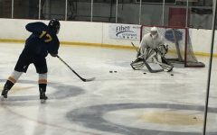 Brian Beck, '22, takes a shot against Brady Mosburger '25 during practice on Monday, Oct. 11 at the Meadville Area Recreational Center.